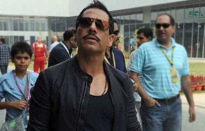 BJP, Congress spar over Vadra's links with absconding arms dealer