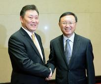 State councilor meets Mongolian deputy PM