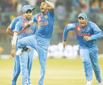 Dhoni masterstrokes guide India in thriller