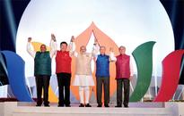 BRICS vows to speed up global recovery  Xi warns of globalization backlash as Modi urges deeper bonds