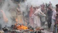 Devotees in Varanasi celebrate Holi with pyre ashes