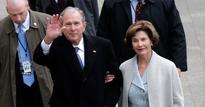 George W. Bush struggles with poncho
