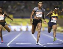 Back to form Blake wins 100m after Bolt's withdrawal