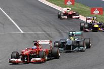 Spanish Grand Prix: Home favourite Fernando Alonso wins amid bedlam in Barcelona