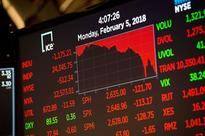 White House moves to reassure markets as Wall Street stocks plunge