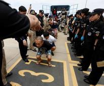 Cambodia deports 25 Taiwanese fraud suspects to China