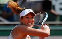The Latest: Halep joins Muguruza in 4th round of French Open