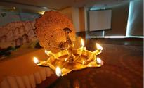 The significance of lighting a lamp ('deepam')