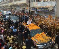PM prays at Kashi Vishwanath, Kal Bhairav temples; leads road show