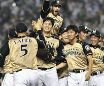 Otani power pitches Fighters to title