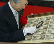 Japan's printing 1.23 billion 10,000-yen bills as people hoard cash at home