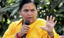 Uma Bharti lashes out at Digvijaya Singhs Nero remark, says Rahul Gandhis heart is burning