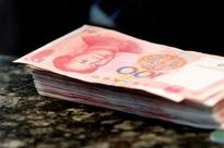 China sees fierce pre-holiday liquidity scramble, short rate surges but yuan dips