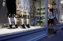 Michael Kors slumps on weak forecast; to shut over 100 stores