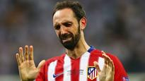 Teary-eyed Juanfran vows Champions League success to Atletico fans
