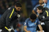 City win but rue Guendogan injury