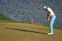 Golf-I am not disappearing, Poulter says after losing U.S. Tour status