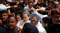 Manmohan, Sonia, Rahul briefly detained during protest