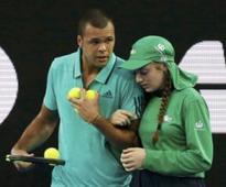 Tsonga helps ailing ball girl