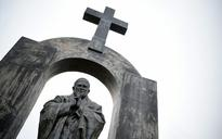 France and Poland clash over court ruling to remove cross from late Pope John Paul II statue