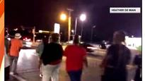 Shots fired, car hits protester at demonstration in Ferguson