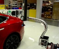 A Tesla owner created a snake-like robotic charger that automatically connects to his Model S