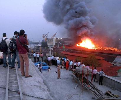 Two navy security boats sink following fire at Mumbai's naval dockyard