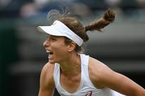 Konta wins first career Wimbledon match in straight sets over Puig