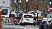 Armed woman in van rams into White House barrier, arrested
