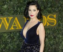 Dita Von Teese has no qualms about wearing flats