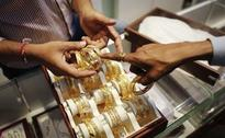 Gold hits two-week low on steadier dollar ahead of Fed meeting