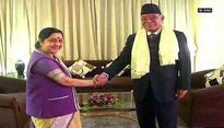 Sushma Swaraj calls on Pushpa Kamal Dahal