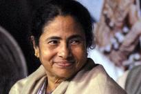 Singur Tata Nano row: Mamata Banerjee hands over 800 compensation cheques to farmers