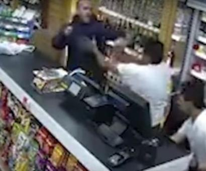 UK: Indian-origin shopkeeper fights off robber using vodka bottle, chair