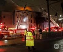 The Latest: Collapse a concern in New Orleans fire battle