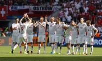 Poland beat Switzerland on penalties to reach quarters