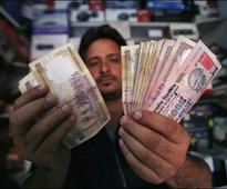 Rupee at over 2-1/2 mth low, down 18 paise against dollar