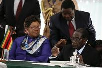 Mugabe signs Zimbabwe constitution, paving way for vote