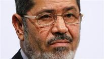 Egypt's Mursi brings more Islamists into cabinet