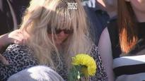 Mother of Manchester attack victim Georgina Callander lays single yellow carnation at vigil in honour of her daughter and eight-year-old Saffie Rose Roussos
