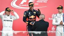 Azerbaijan GP: Daniel Ricciardo wins chaotic race, Vettel penalised for swerving into rival Hamilton