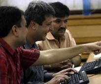 Sensex hits record high; rupee at 20-month high