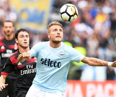 Football Briefs: Immobile hat-trick destroys Milan's perfect record