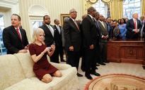 Donald Trump aide Kellyanne Conway kneels on Oval Office couch, sparks outrage