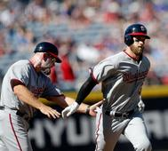 Murphy a huge hit in Nats debut, 4-3 win over Braves in 10