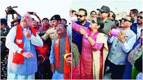 Amit Shah, CM Vijay Rupani fly kites, take part in celebrations
