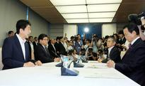 Abe promises to use 'all tools' to stabilize markets