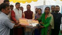 Jugal distributes LPG connection to BPL families