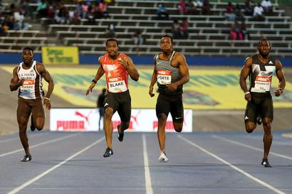 Blake completes Jamaican sprint double in Bolt's absence