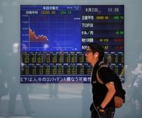Asian shares retreat from highs on doubts over Trump tax plan